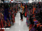 """Shopping in Makati; some of these flowery dresses are what they call """"hospital gowns"""""""