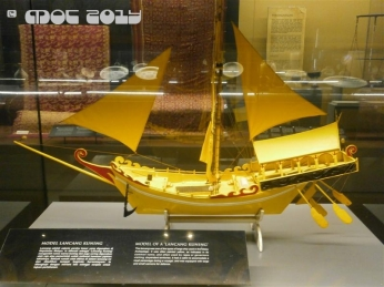 "MODEL OF A ""LANCANG KUNING"" The ""lancang"" was one of the types of large ship used in the Malay archipelago. It was often painted yellow, as indicated in its common name (kuning), and often used by rajas or governors visiting dependent territories. It had a cabin to accomodate a royal personage during a voyage, and was equipped with large and small cannons for defence."